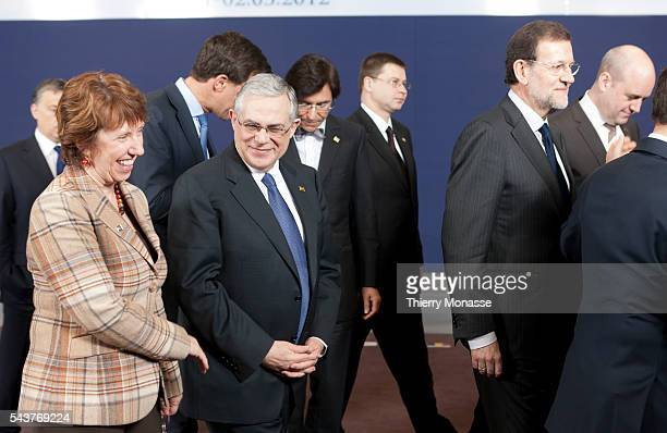 Brussels Belgium March 1 2012 EU high representative Catherine Ashton talks with the Greek Prime Minister Lucas Papademos during a familly photo