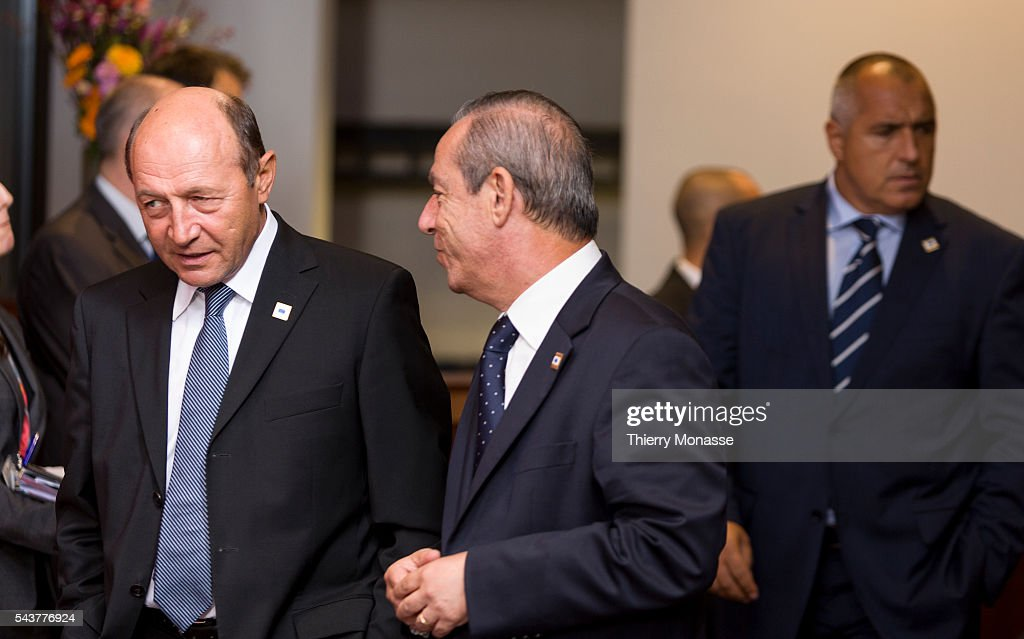 Brussels Belgium October 18 2012 Romanian President Traian BASESCU is talking with the Maltese Prime Minister Lawrence GONZI prior to a family photo...