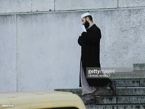 One of the suspect leaves 03 November 2004 the courthouse in Brussels after the start the trial of 13 alleged members of the radical Moroccan Islamic...
