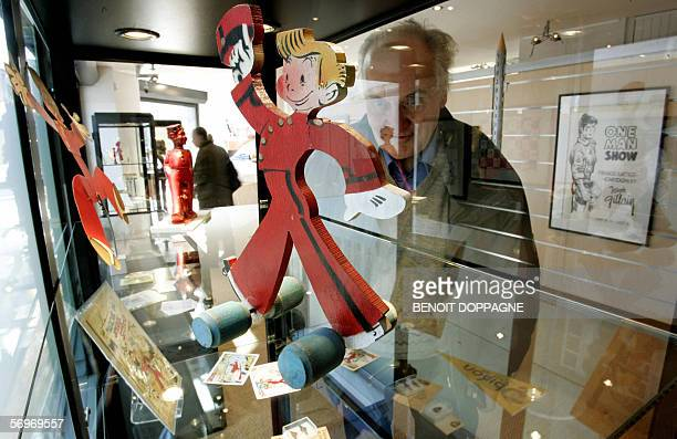 Picture of a visitor looking at exhibits 01 March 2006 inside the newly opened ' Maison de la Bande Dessinee ' in Brussels AFP PHOTO / BELGA / BENOIT...