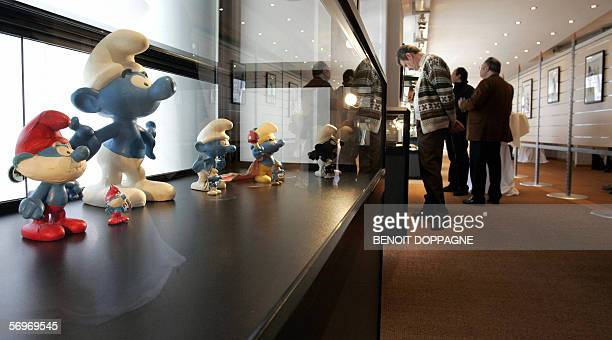 Picture of visitors looking at exhibits near the 'smurfs' 01 March 2006 inside the newly opened ' Maison de la Bande Dessinee ' in Brussels AFP PHOTO...
