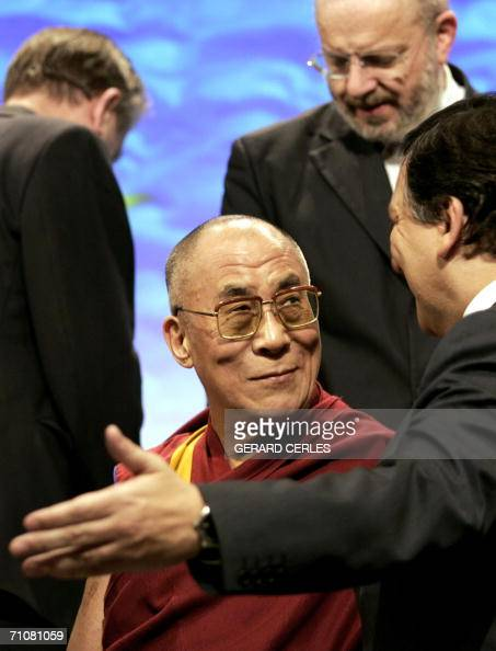 Tibetan spiritual leader the Dalai Lama chats with EU commission chief Jose Manuel Barroso prior to a family photo following a conference with...