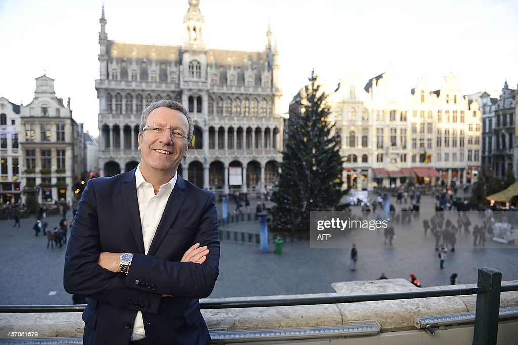 Brussels City mayor Yvan Mayeur poses on the balcony of the city hall at the Grand Place in Brussels after the press conference to present the 2014 budget of Brussels city, on December 16, 2013.