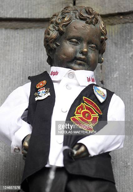 Brussels' iconic Manneken Pis statue wears the costume of Motorcycling and Fire Fighters club 'Red Knights Belgium 1' to honour the American fire...
