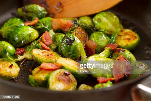 Brussels sprouts cooking in a skillet