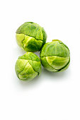 three Fresh green Brussels sprouts isolated on white background