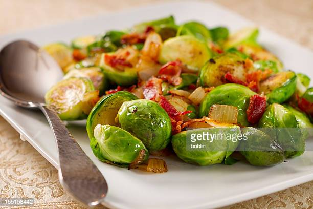 Brussels sprouts with a metal spoon