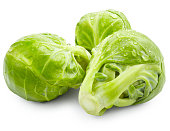 Brussels sprouts with drops of water  isolated on white background
