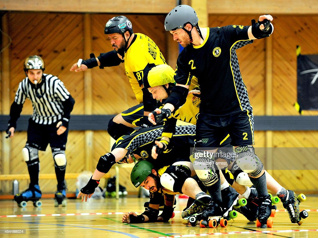 Brutal Delux of Panam Squad and Super Nashwan of Crash Test Brummies bout in the Men's European Cup roller derby tournament at Walker Activity Dome on August 31, 2014 in Newcastle upon Tyne, England.