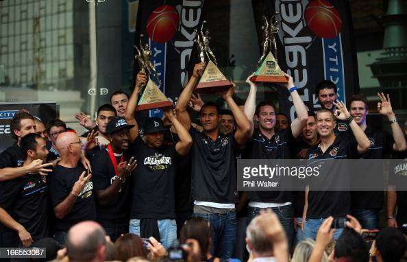 CJ Bruton Mika Vukona and Dillon Boucher of the New Zealand Breakers hold up their Championship trophys from the last three years during a homecoming...
