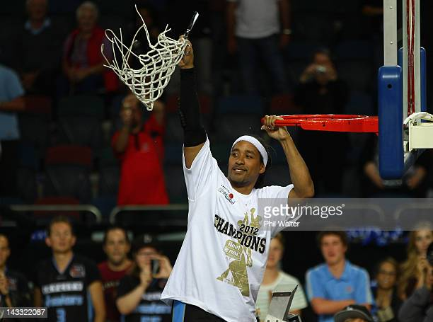 Bruton of the Breakers holds up the net following game three of the NBL Grand Final series between the New Zealand Breakers and the Perth Wildcats at...