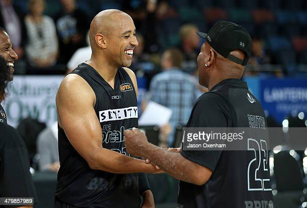 Bruton of the Breakers shares a moment with his father Calvin Bruton after the round 23 NBL match between the New Zealand Breakers and the Cairns...