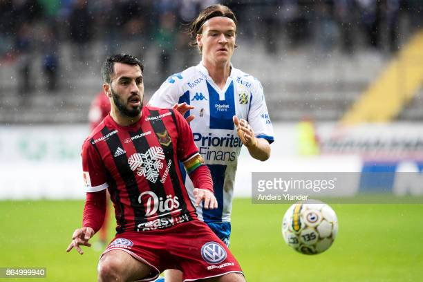 Brwa Nouri of Ostersunds FK competes for the ball with August Erlingmark of IFK Goteborg during the Allsvenskan match between IFK Goteborg and...