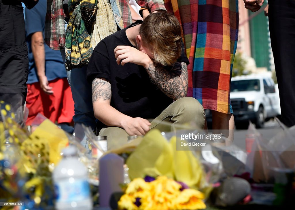 Bry Thompson, 21, of Las Vegas wipes his eyes at a makeshift memorial set up across from the Las Vegas Village on October 4, 2017 in Las Vegas, Nevada. Thompson had friends attending the Route 91 Harvest country music festival when a lone gunman opened fire on the crowd killing at least 59 people and injuring more than 500. The massacre is one of the deadliest mass shooting events in U.S. history. Thompson's friends were unhurt.
