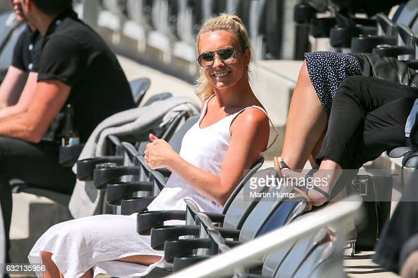 Brya Fahy partner of Tim Southee of New Zealand relaxes while watching day one of the Second Test match between New Zealand and Bangladesh at Hagley...