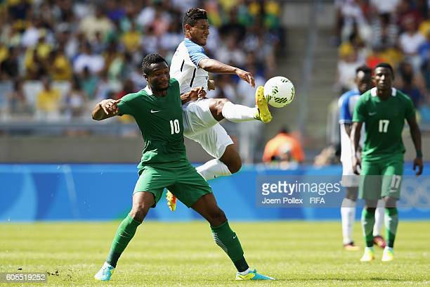 Bryan Acosta of Honduras and John Obi Mikel of Nigeria compete for the bal during the Men's Olympic Football Bronze Medal match between Honduras and...