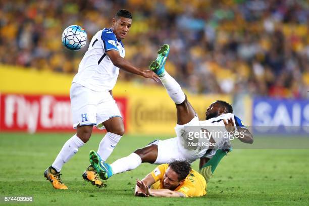 Bryan Acosta of Honduras and Johnny Palacios of Honduras tackle Mark Milligan of Australia during the 2018 FIFA World Cup Qualifiers Leg 2 match...