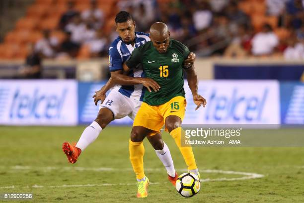 Bryan Acosta of Honduras challenges Florent Malouda of French Guiana during the 2017 CONCACAF Gold Cup Group A match between Honduras and French...