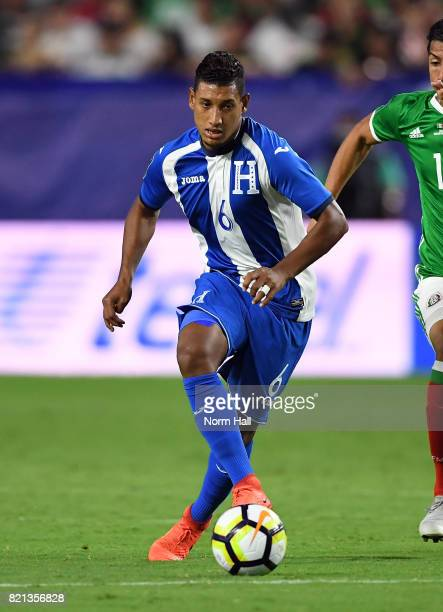 Bryan Acosta of Honduras controls the ball against Mexico in a quarterfinal match during the CONCACAF Gold Cup at University of Phoenix Stadium on...