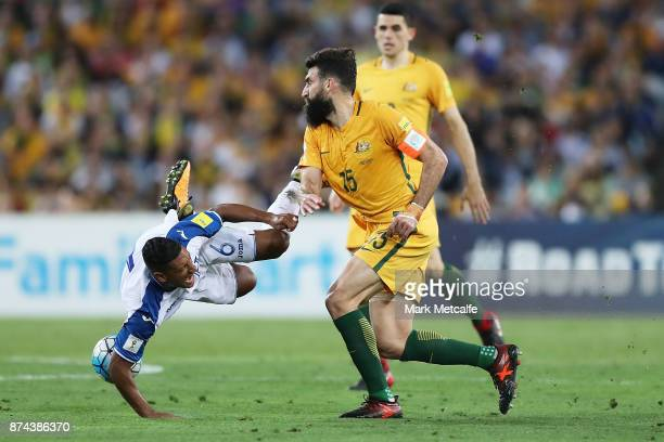 Bryan Acosta of Honduras is tackled by Mile Jedinak of Australia during the 2018 FIFA World Cup Qualifiers Leg 2 match between the Australian...
