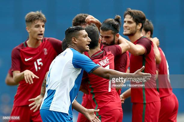 Bryan Acosta of Honduras reacts whilst player of Portugal celebrate the fisrt team goal during the Men's Group D first round match between Honduras...