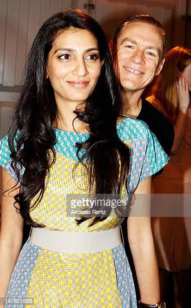 Bryan Adams and Escada owner Megha Mittal pose backstage prior the Escada Show at the MercedesBenz Fashion Week Spring/Summer 2013 on July 4 2012 in...