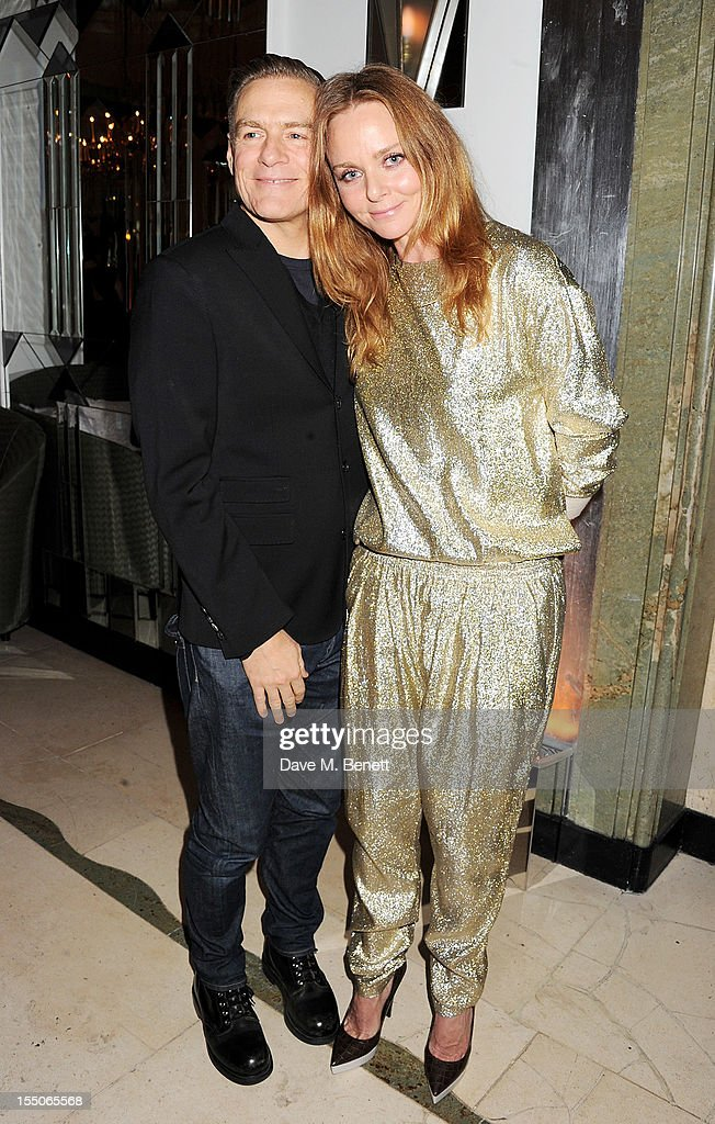 Bryan Adams (L) and Stella McCartney attend the Harper's Bazaar Women of the Year Awards 2012, in association with Estee Lauder, Harrods and Tiffany & Co., at Claridge's Hotel on October 31, 2012 in London, England.