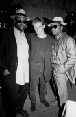 Bryan Adams poses for a portrait with producers Jimmy Jam and Terry Lewis at an AM records party at Murray's restaurant in Minneapolis Minnesota in...