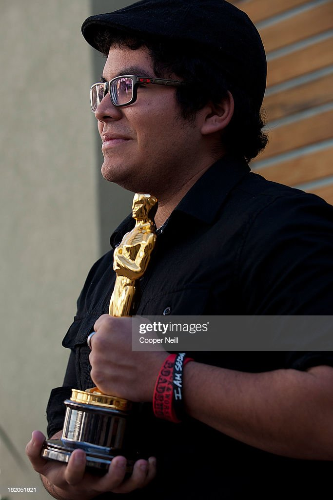 Bryan Aguilar poses with an Oscar trophey during First-Ever Oscar Roadtrip at the Angelika Film Center on February 18, 2013 in Dallas.