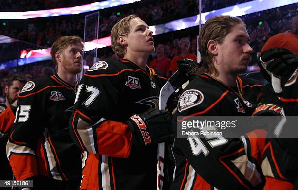 Bryan Allen Hampus Lindholm and Sami Vatanen of the Anaheim Ducks stand during the national anthem before the game against the Los Angeles Kings in...