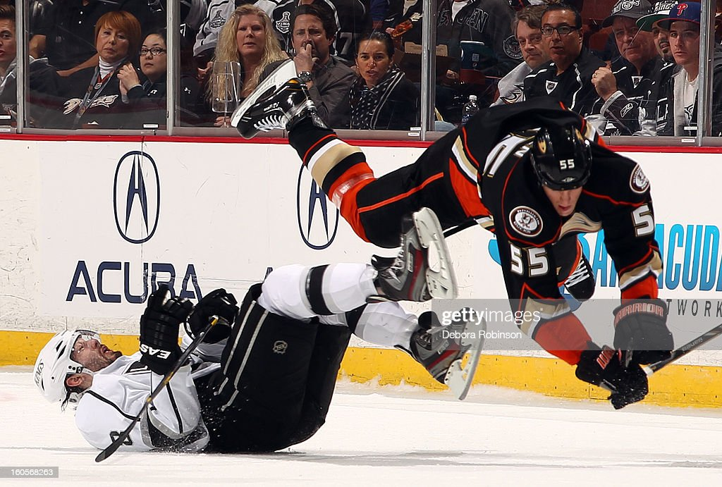 Bryan Allen #55 of the Anaheim Ducks flys over a falling Drew Doughty #8 of the Los Angeles Kings on February 2, 2013 at Honda Center in Anaheim, California.