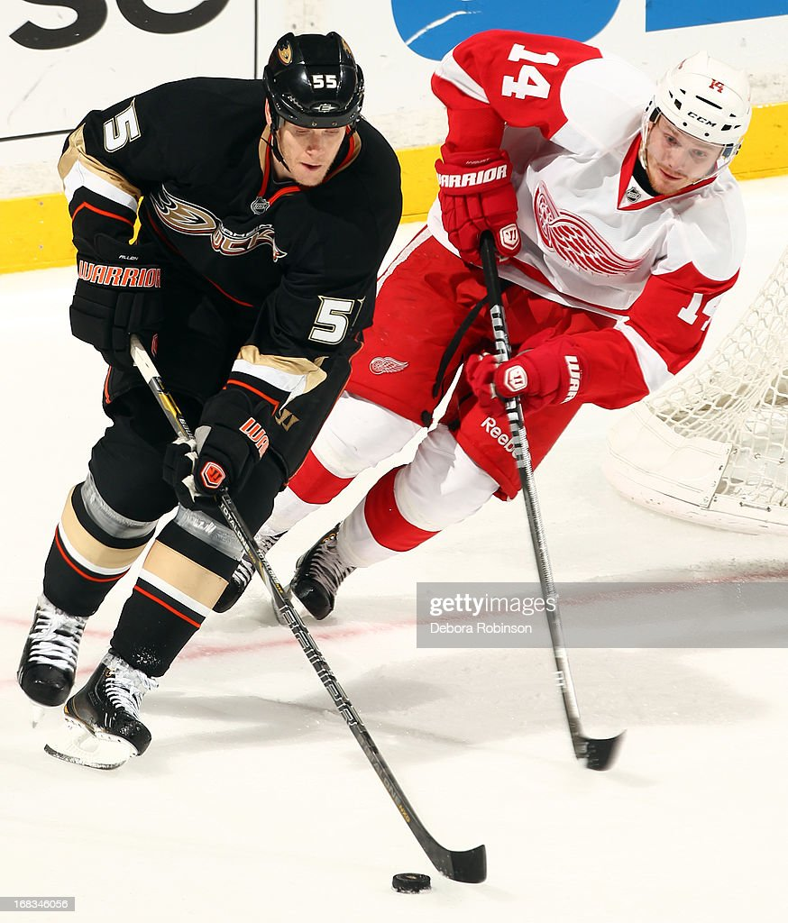 Bryan Allen #55 of the Anaheim Ducks handles the puck against Gustav Nyquist #14 of the Detroit Red Wings in Game Five of the Western Conference Quarterfinals during the 2013 NHL Stanley Cup Playoffs at Honda Center on May 8, 2013 in Anaheim, California.