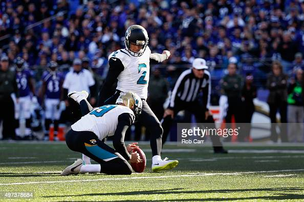Bryan Anger holds the ball as kicker Jason Myers of the Jacksonville Jaguars kicks an extra point in the second half against the Baltimore Ravens at...