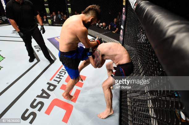 Bryan Barberena lands a knee to the head of Joe Proctor in their welterweight bout during the UFC Fight Night event at Bridgestone Arena on April 22...