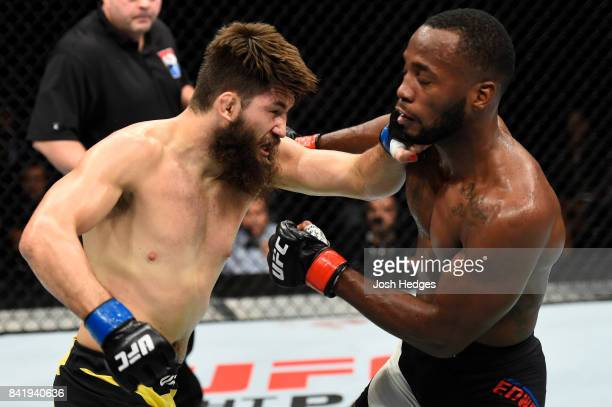 Bryan Barberena punches Leon Edwards of Jamaica in their welterweight bout during the UFC Fight Night event at the Rotterdam Ahoy on September 2 2017...