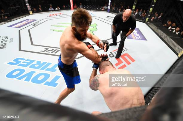 Bryan Barberena throws an elbow to the head of Joe Proctor in their welterweight bout during the UFC Fight Night event at Bridgestone Arena on April...