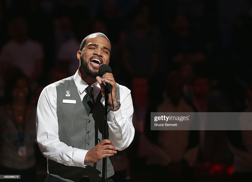 Bryan Bautista, an usher at the arena, sings the national anthem prior to the game between the Brooklyn Nets and the New York Knicks at the Barclays Center on April 15, 2014 in the Brooklyn borough of New York City.