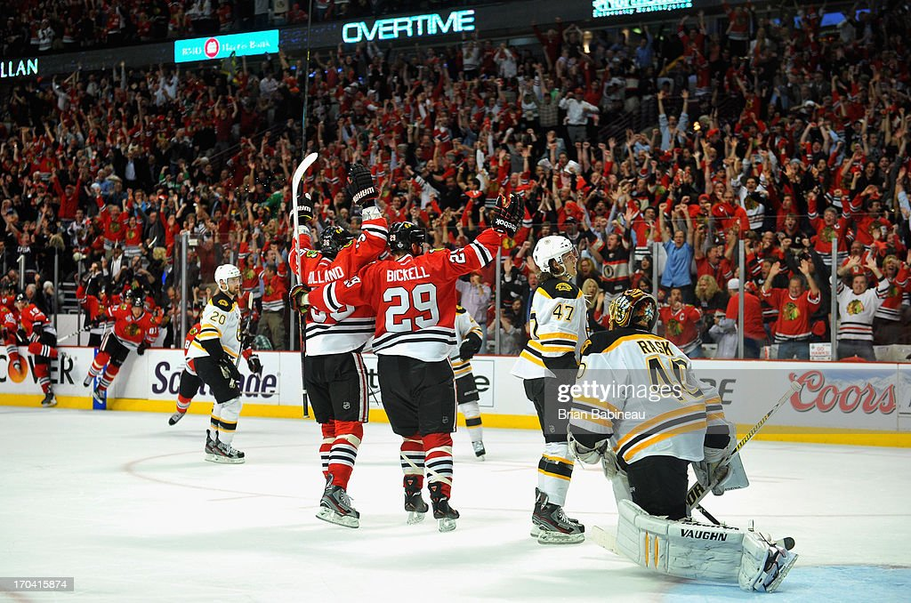 Bryan Bickell #29 and Dave Bolland #36 of the Chicago Blackhawks celebrate after teammate Andrew Shaw #65 (not pictured) scored the game-winning goal in the third overtime of Game One of the 2013 Stanley Cup Final against the Boston Bruins at the United Center on June 12, 2013 in Chicago, Illinois. The Chicago Blackhawks won the game 4-3.