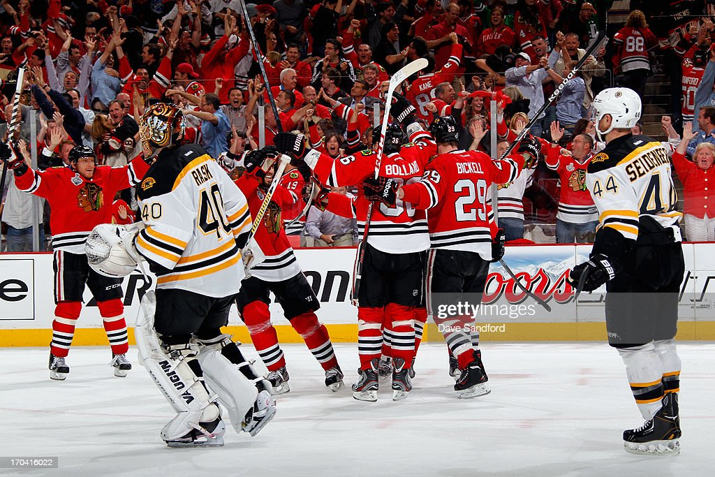 Bryan Bickell #29 and Dave Bolland #36 of the Chicago Blackhawks celebrate after teammate Andrew Shaw #65 scored the game-winning goal in the third overtime of Game One of the 2013 Stanley Cup Final to beat the Boston Bruins 4-3 at the United Center on June 12, 2013 in Chicago, Illinois.