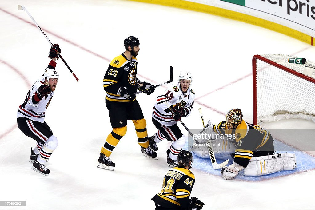 <a gi-track='captionPersonalityLinkClicked' href=/galleries/search?phrase=Bryan+Bickell&family=editorial&specificpeople=241498 ng-click='$event.stopPropagation()'>Bryan Bickell</a> #29 and <a gi-track='captionPersonalityLinkClicked' href=/galleries/search?phrase=Jonathan+Toews&family=editorial&specificpeople=537799 ng-click='$event.stopPropagation()'>Jonathan Toews</a> #19 of the Chicago Blackhawks celebrate after Brent Seabrook #7 (not pictured) scores the game winning goal against <a gi-track='captionPersonalityLinkClicked' href=/galleries/search?phrase=Tuukka+Rask&family=editorial&specificpeople=716723 ng-click='$event.stopPropagation()'>Tuukka Rask</a> #40 of the Boston Bruins in overtime in Game Four of the 2013 NHL Stanley Cup Final at TD Garden on June 19, 2013 in Boston, Massachusetts.