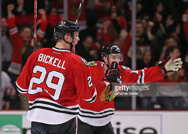 Bryan Bickell and Jonathan Toews of the Chicago Blackhawks celebrate bickell's gametying goal in the third period against the St Louis Blues in Game...
