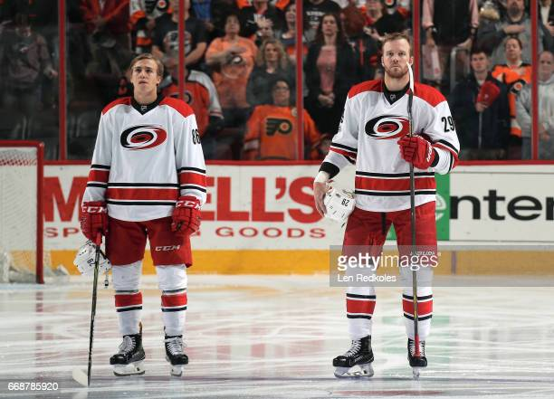 Bryan Bickell and Teuvo Teravainen of the Carolina Hurricanes stand on the blue line during the National Anthem prior to the start of their game...