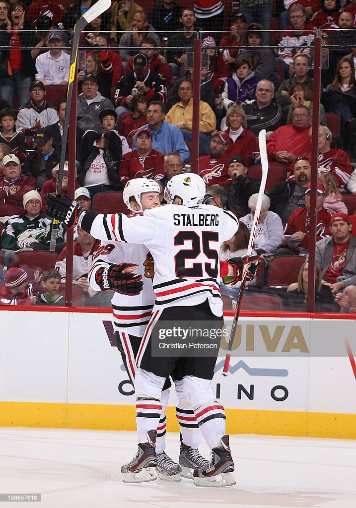 <a gi-track='captionPersonalityLinkClicked' href=/galleries/search?phrase=Bryan+Bickell&family=editorial&specificpeople=241498 ng-click='$event.stopPropagation()'>Bryan Bickell</a> #29 and <a gi-track='captionPersonalityLinkClicked' href=/galleries/search?phrase=Viktor+Stalberg&family=editorial&specificpeople=5802237 ng-click='$event.stopPropagation()'>Viktor Stalberg</a> #25 of the Chicago Blackhawks celebrate after scoring against the Phoenix Coyotes during the NHL game at Jobing.com Arena on January 20, 2013 in Glendale, Arizona. The Blackhawks defeated the Coyotes 6-4.