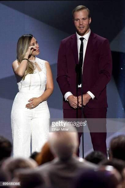 Bryan Bickell and wife Amanda Bickell speak onstage during the 2017 NHL Awards and Expansion Draft at TMobile Arena on June 21 2017 in Las Vegas...