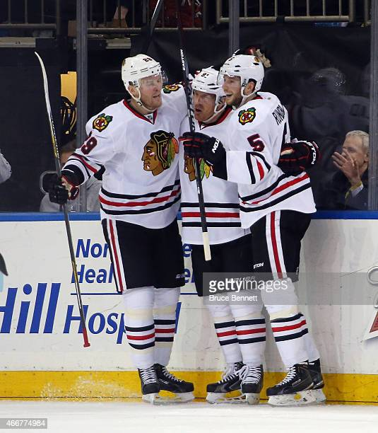 Bryan Bickell Brad Richards and David Rundblad of the Chicago Blackhawks celebrate Richards game winning goal at 719 of the third period against the...