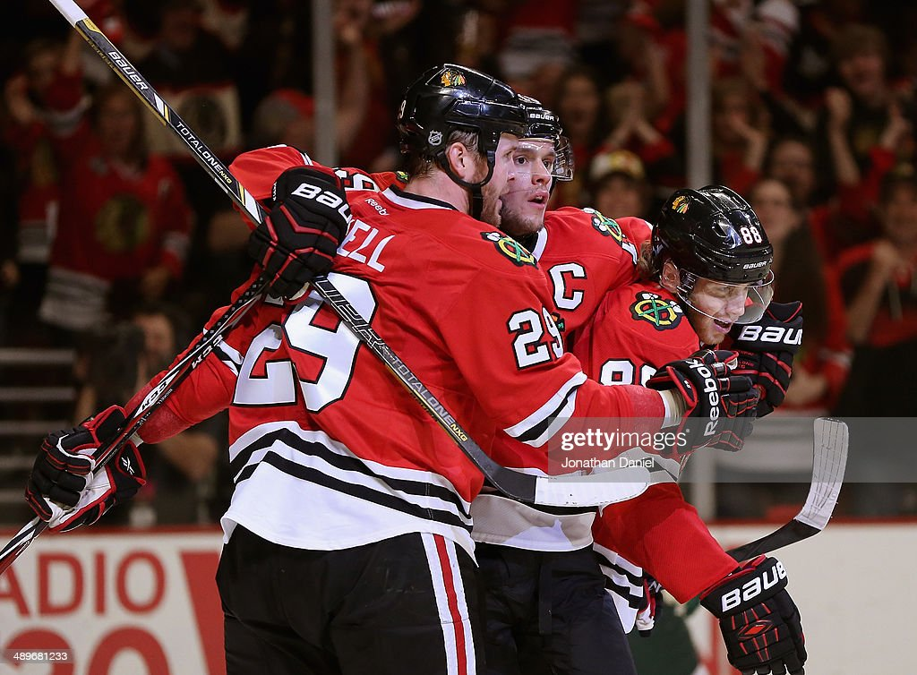 <a gi-track='captionPersonalityLinkClicked' href=/galleries/search?phrase=Bryan+Bickell&family=editorial&specificpeople=241498 ng-click='$event.stopPropagation()'>Bryan Bickell</a> #29, <a gi-track='captionPersonalityLinkClicked' href=/galleries/search?phrase=Jonathan+Toews&family=editorial&specificpeople=537799 ng-click='$event.stopPropagation()'>Jonathan Toews</a> #19 and Partick Kane #88 of the Chicago Blackhawks celebrate Bickell's second period goal against the Minnesota Wild in Game Five of the Second Round of the 2014 NHL Stanley Cup Playoffs at the United Center on May 11, 2014 in Chicago, Illinois.