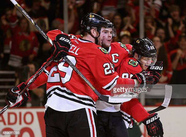 Bryan Bickell Jonathan Toews and Partick Kane of the Chicago Blackhawks celebrate Bickell's second period goal against the Minnesota Wild in Game...