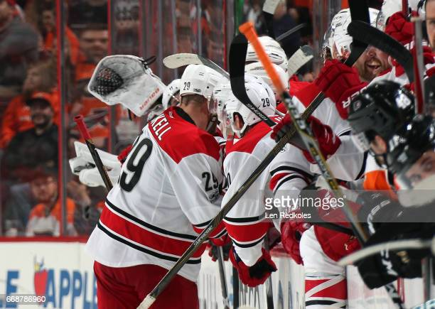 Bryan Bickell of the Carolina Hurricanes celebrates with his teammates on the bench after scoring a goal in the shootout against the Philadelphia...