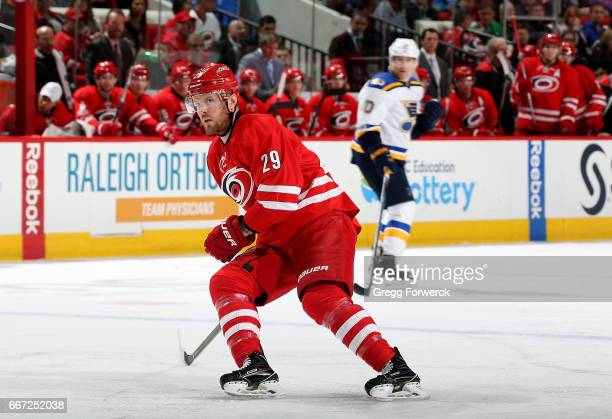Bryan Bickell of the Carolina Hurricanes skates for position on the ice against the St Louis Blues during an NHL game on April 8 2017 at PNC Arena in...