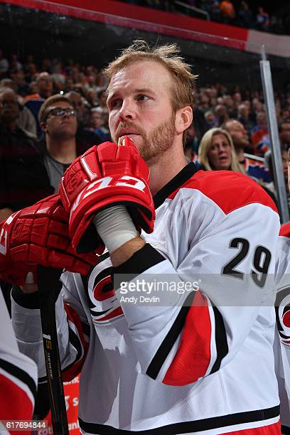 Bryan Bickell of the Carolina Hurricanes stands for the singing of the national anthem prior to the game against the Edmonton Oilers on October 18...